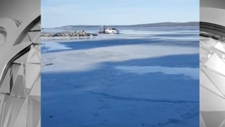 Man Captures The Instant When A Cadillac Escalade Falls Through Thin Ice On Lake Michigan And Gets Stuck