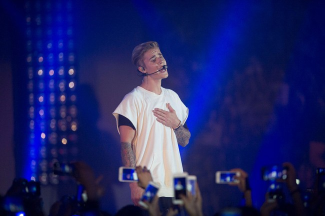 HONG KONG - JUNE 11:  Justin Bieber performs at the Calvin Klein Jeans music event in Hong Kong with special appearance from Justin Bieber and performances by Jay Park, Kevin Poon, Joon & Verbal at the Kai Tak Cruise Terminal, Hong Kong, Thursday, June 11, 2015.