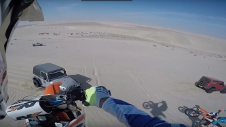 Dirt Bike Bro Smashes Into The Hood Of A Jeep Wrangler After Nailing A Sick Jump