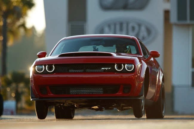 The 2018 Dodge Challenger SRT Demon, powered by an 840-horsepower supercharged 6.2-liter HEMI® V-8, is the world's first production car to lift the front wheels at launch. It set the world record for longest wheelie from a standing start by a production car at 2.92 feet, certified by Guinness World Records. The Dodge Challenger SRT Demon was unveiled Tuesday evening, April 11, ahead of the New York International Auto Show. (PRNewsfoto/FCA US LLC)