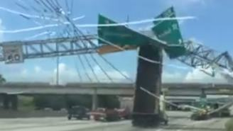 Watch A Dump Truck Flip After Colliding With A Sign Because It Was Driving With The Bed Up