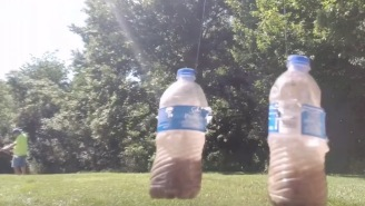 Archer Pulls Off The Craziest Trick Shot Ever And Hits Two Swinging Bottles With One Arrow