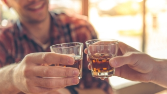 Here's Why People Tap Their Glass On The Bar Before Taking A Shot