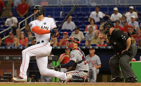 MIAMI, FL - JUNE 21:  Giancarlo Stanton #27 of the Miami Marlins hits the go ahead run on an RBI single in the eighth inning a game against the Washington Nationals at Marlins Park on June 21, 2017 in Miami, Florida.  (Photo by Mike Ehrmann/Getty Images)