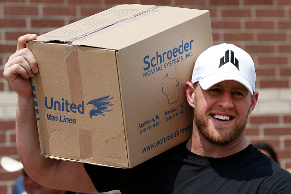Houston Texans defensive end J.J. Watt holds a box of relief supplies on his shoulder while handing them out to people impacted by Hurricane Harvey