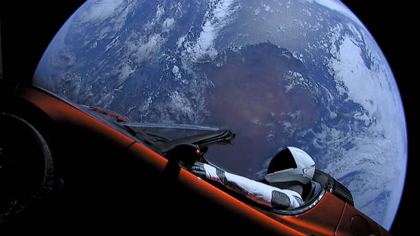 """SpaceX, a Tesla roadster launched from the Falcon Heavy rocket with a dummy driver named """"Starman"""" heads towards Mars. (Photo by SpaceX via Getty Images)"""