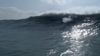 Footage Shows How Dangerous Big Wave Surfing Can Be When Surfer And Rescuer Get Rocked By Waves