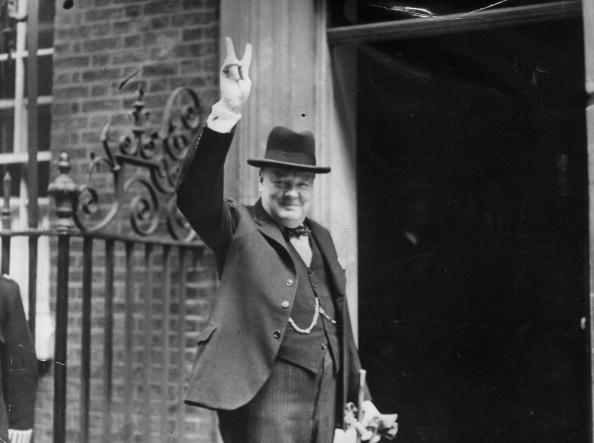 Prime Minister Winston Churchill outside 10 Downing Street, gesturing his famous 'V for Victory' hand signal, June 1943.