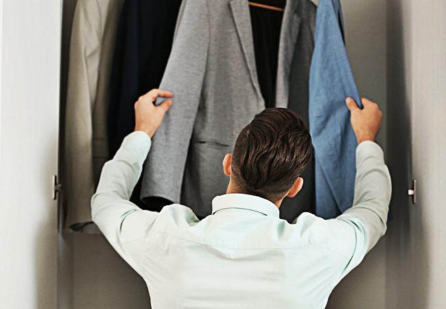 man looking in closet