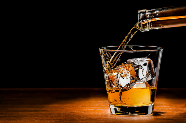 pouring whiskey on the rocks