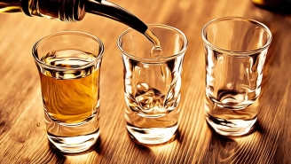 Why Do People Tap Their Shot Glass On The Bar Before Drinking It? Here Are The Leading Theories