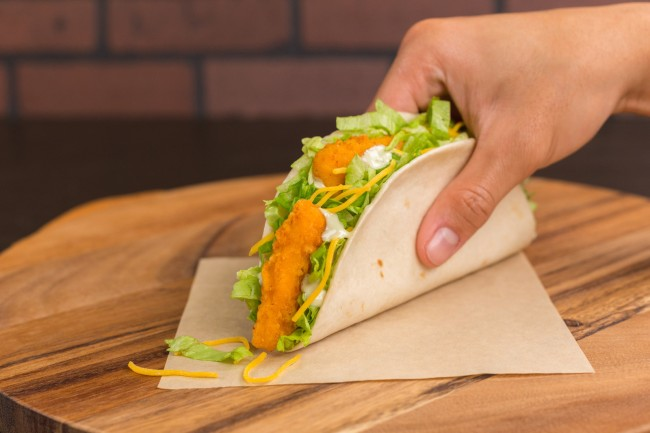 The newest cheesy offerings plus the test of the $1 Crispy Chicken Taco in Oklahoma City, OK and fan-favorite Beefy Crunch Burrito for $1 in Chattanooga, TN reinforce the brand's 2018 dedication to innovative value without compromise. (PRNewsfoto/Taco Bell Corp.)
