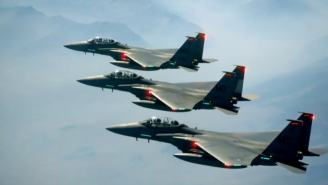 Watch Incredible Footage Of Three F-15 Fighter Jets Race A Solar Eclipse