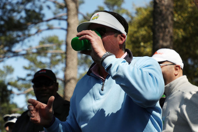 fan chugging beer the masters
