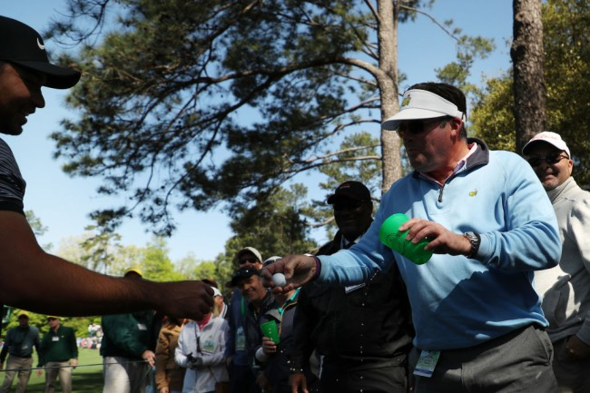 fan handing jason day ball beer the masters