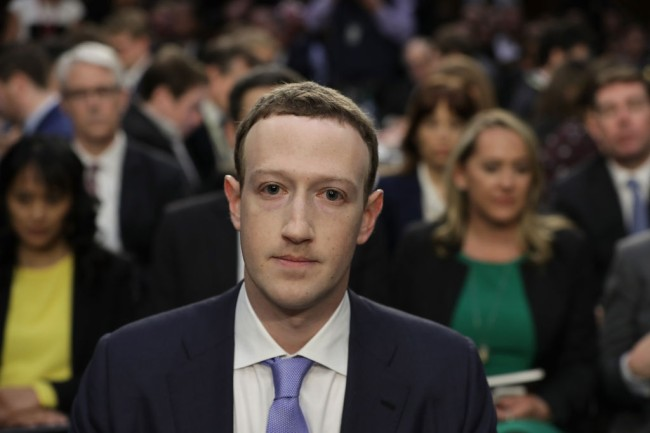 WASHINGTON, DC - APRIL 10: Facebook co-founder, Chairman and CEO Mark Zuckerberg arrives to testify before a combined Senate Judiciary and Commerce committee hearing in the Hart Senate Office Building on Capitol Hill April 10, 2018 in Washington, DC. Zuckerberg, 33, was called to testify after it was reported that 87 million Facebook users had their personal information harvested by Cambridge Analytica, a British political consulting firm linked to the Trump campaign.