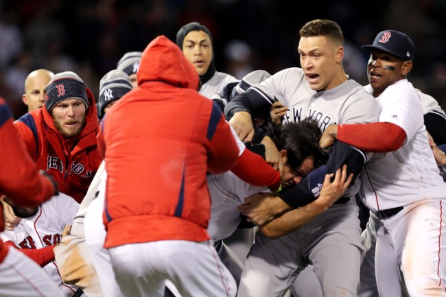 BOSTON, MA - APRIL 11: From left, Chris Sale #41 of the Boston Red Sox, Giancarlo Stanton #27 of the New York Yankees, Aaron Judge #99 of the New York Yankees and Rafael Devers #11 of the Red Sox work to separate a fight involving Joe Kelly #56 of the Boston Red Sox and Tyler Austin #26 of the New York Yankees during the seventh inning at Fenway Park on April 11, 2018 in Boston, Massachusetts. Austin rushed the mound after being struck by a pitch thrown by Kelly.
