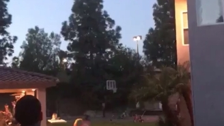 Perfect 50+ Yard Spiral Through A Basketball Hoop Even More Impressive Considering This Guy's Athletic Background