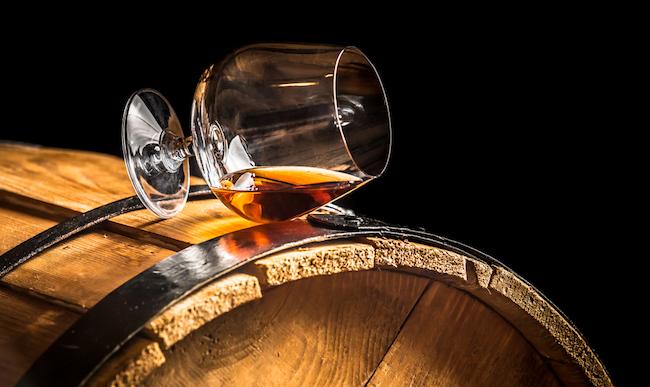 whiskey glass on barrel