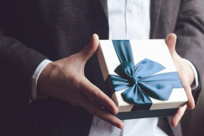 man holding gift