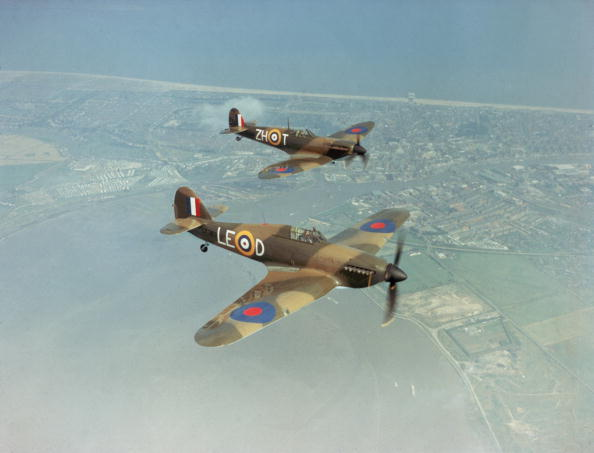 A Hawker Hurricane IIc LF363 (foreround), and a Supermarine Spitfire IIa P7350 with markings as they appeared in Guy Hamilton's film 'Battle Of Britain', 1969. Built in 1940, the Spitfire took part in the Battle of Britain, serving with 266 Squadron and 603 (City of Edinburgh) AuxAF Squadron. The Hurricane was built in 1944 and is believed to be the last Hurricane to enter service with the RAF. Both aircraft are still flying with the Battle of Britain Memorial Flight. (Photo by Fox Photos/Getty Images)