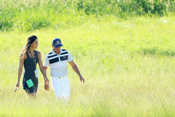 Rickie Fowler of the United States walks along the course with Allison Stokke during a practice round prior to the 2017 U.S. Open at Erin Hills on June 14, 2017 in Hartford, Wisconsin. (Photo by Andrew Redington/Getty Images)