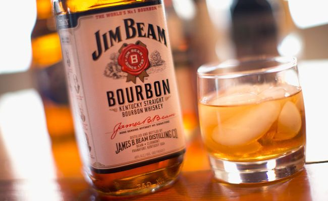 jim beam bottle with glass of whiskey