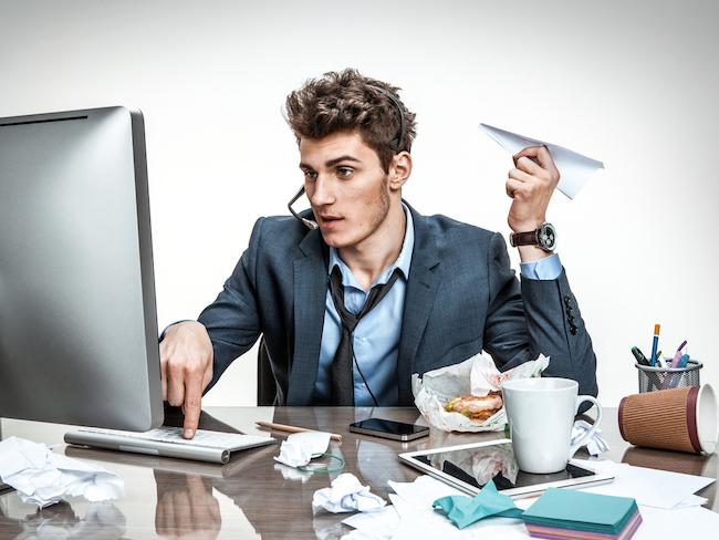 man at messy desk