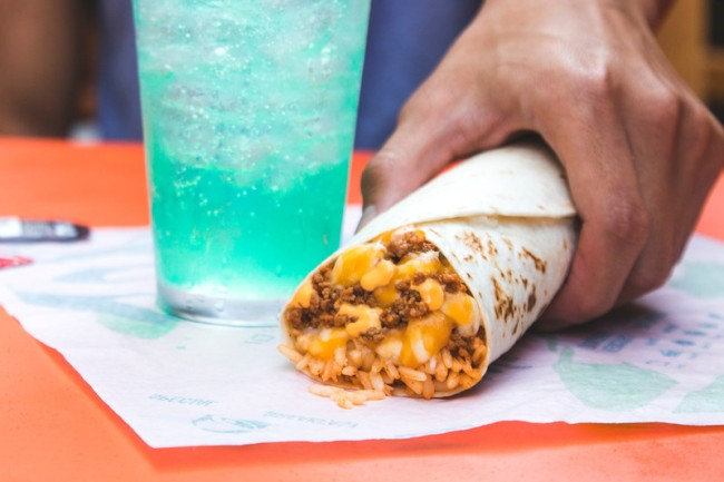 The $2 Duo is Taco Bell's new power couple and brings fans iconic items only Taco Bell could offer, including the Triple Melt Burrito and a Baja Blast, or any other beverage of choice, for just $2, and is available nationwide starting June 24. (PRNewsfoto/Taco Bell Corp.)