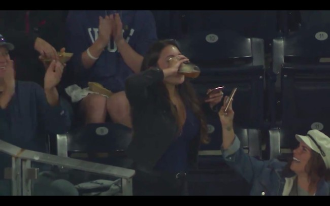 woman catches foul ball chugs beer