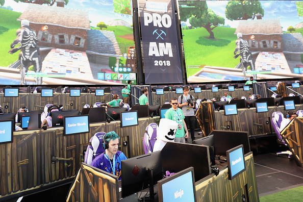 Gamers 'Ninja' (L) and 'Marshmello' compete in the Epic Games Fortnite E3 Tournament at the Banc of California Stadium on June 12, 2018 in Los Angeles, California.