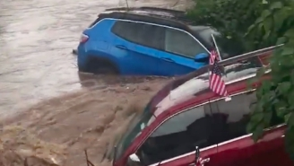 Torrential Rain Resulted In A Literal River Of Cars Pouring Out Of A Jeep Dealership In New Jersey
