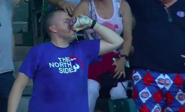 cubs fan chugs beer foul ball