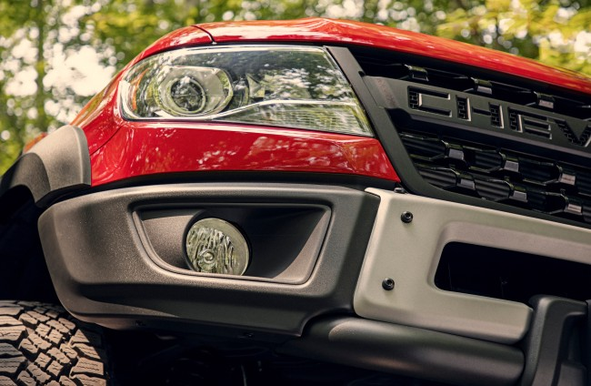 AEV-designed stamped steel front bumpers feature fog lights and winch provisions.