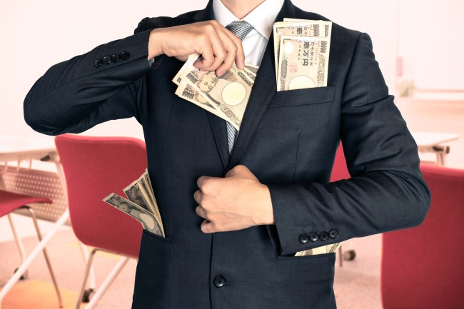 Businessman holding money at the seminar.
