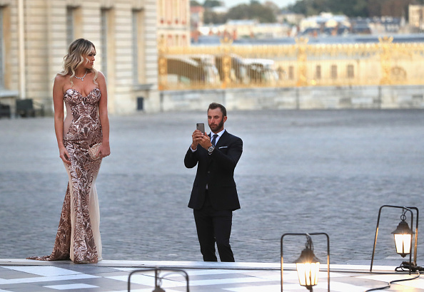 VERSAILLES, FRANCE - SEPTEMBER 26:  Dustin Johnson of the United States and his partner Paulina Gretzky arrive at the Ryder Cup Gala dinner at the Palace of Versailles ahead of the 2018 Ryder Cup on September 26, 2018 in Versailles, France.  (Photo by Andrew Redington/Getty Images)