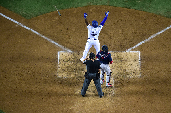 LOS ANGELES, CA - OCTOBER 27: Yasiel Puig #66 of the Los Angeles Dodgers hits a three-run home run in the sixth inning of Game Four of the 2018 World Series against pitcher Eduardo Rodriguez #57 of the Boston Red Sox (not in photo) at Dodger Stadium on October 27, 2018 in Los Angeles, California. (Photo by Harry How/Getty Images)