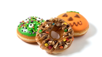 Krispy Kreme's New Candy-Covered Trick-Or-Treat Doughnut Is What America Deserves This Halloween