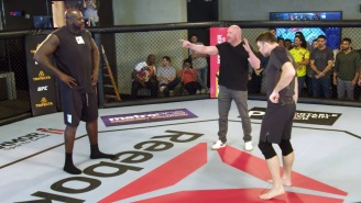 Watch Shaq Take On UFC Legend Forrest Griffin Inside The Octagon, Get Choked Out By A 115-Pound Female Fighter