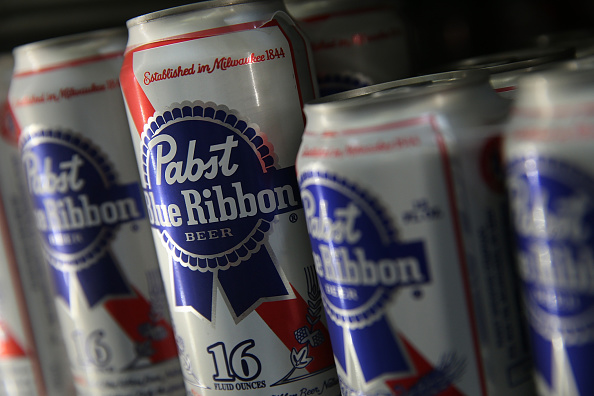 SAN FRANCISCO, CA - SEPTEMBER 22: Cans of Pabst Blue Ribbon beer sit on a shelf at a convenience store on September 22, 2014 in San Francisco, California. Pabst Brewing Co., the maker of Pabst Blue Ribbon announced that they are selling their company to Russian company Oasis Beverages for an undisclosed sales price. (Photo by Justin Sullivan/Getty Images)