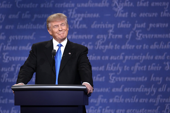 HEMPSTEAD, NY - SEPTEMBER 26:  Republican presidential nominee Donald Trump smiles during the Presidential Debate at Hofstra University on September 26, 2016 in Hempstead, New York.  The first of four debates for the 2016 Election, three Presidential and one Vice Presidential, is moderated by NBC's Lester Holt.  (Photo by Win McNamee/Getty Images)