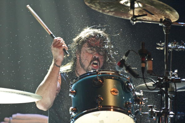 LONDON, UNITED KINGDOM - DECEMBER 17: Dave Grohl of Them Crooked Vultures performs on stage playing drums at Hammersmith Apollo on December 17, 2009 in London, England. (Photo by Neil Lupin/Redferns)