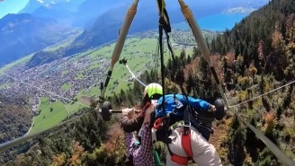 Hang Glider Jumps Off A Mountain Without Remembering To Strap In And Holds On For Dear Life