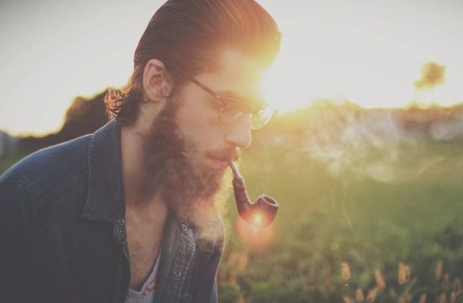 hipster smoking pipe