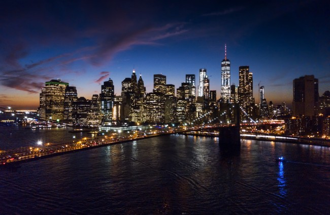 Aerial view of Brooklyn bridge and New York cityscape at night