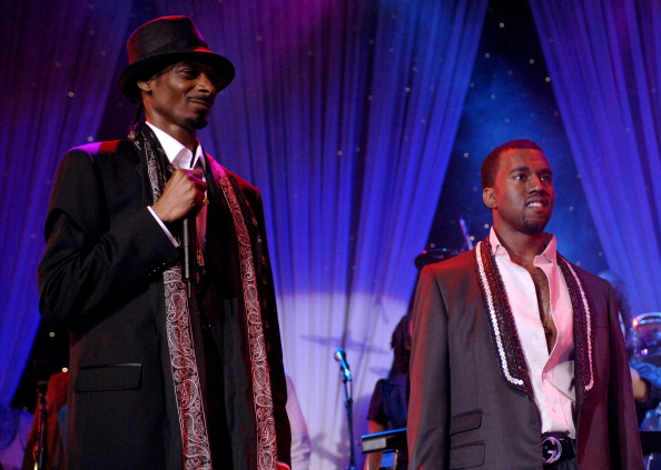Snoop Dogg and Kanye West perform during 2006 Clive Davis Pre-GRAMMY Awards Party - Show at Beverly Hilton in Beverly Hills, California, United States. (Photo by L. Busacca/WireImage for J Records)