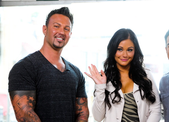 """LOS ANGELES, CA - JULY 23:  Roger Mathew (L) and Jennifer """"JWoww"""" Farley visit """"Extra"""" at The Grove on July 23, 2012 in Los Angeles, California.  (Photo by Noel Vasquez/Getty Images for Extra)"""