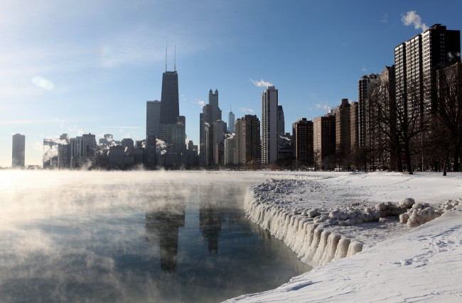 """CHICAGO - JANUARY 07:  The Chicago Skyline, as photographed from North Avenue Beach as steam rises from Lake Michigan due to the """"Polar Vortex"""" sending temperatures well below zero in Chicago, Illinois on JANUARY 07, 2014.  (Photo By Raymond Boyd/Getty Images)"""
