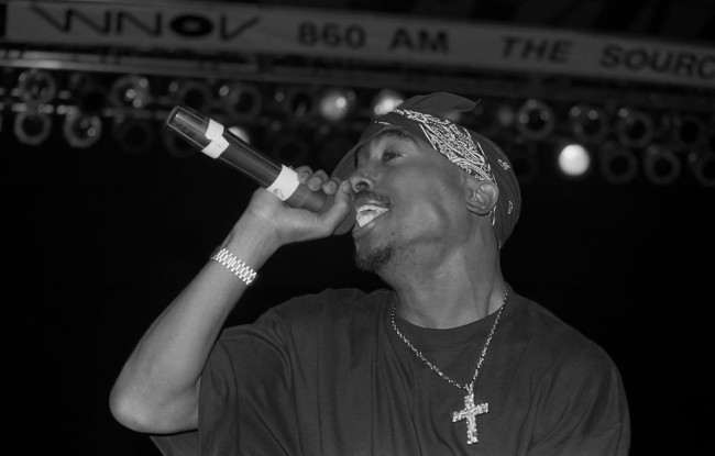 MILWAUKEE - SEPTEMBER 1994:  Rapper Tupac Shakur performs at the Mecca Arena in Milwaukee, Wisconsin in September 1994.  (Photo By Raymond Boyd/Getty Images)