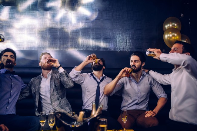 Group of young men drinking beer